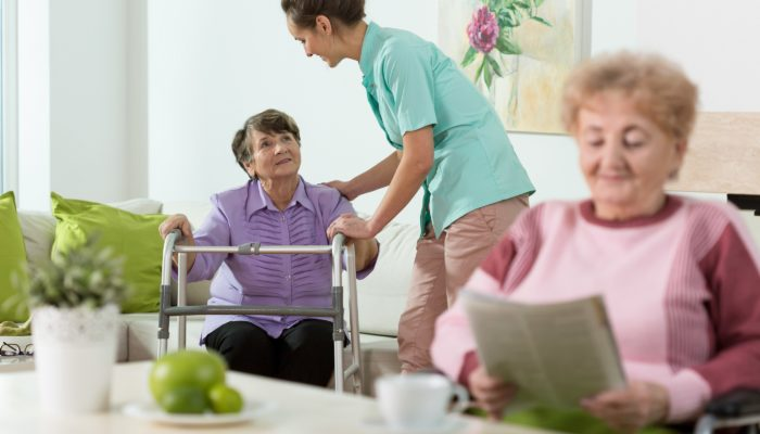 Disabled senior women staying in care home