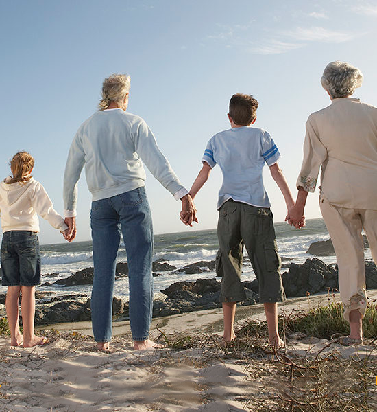 Senior-Living-Generational-Family-on-Beach-SMALL-550x600